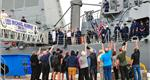 Protecteur civilians cheer USS Michael Murphy: Photo credit USN