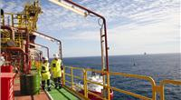 Fire Protection: Staff aboard a floating producer pass several coatings types. (Photo: Øyvind Hagen, Statoil)