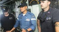 Petty Officer Third Class Higuchi Shoma, Japanese Maritime Self Defense Force (JMSDF), center, pilots USS Pioneer during 2JA 2017 Mine Countermeasures Exercise (2JA-17 MCMEX) as Mineman First Class Zachary Abel, right, observes. 2JA Mine Countermeasures Exercise is an annual bilateral exercise held between the U.S. Navy and JMSDF to strengthen interoperability and increase proficiencies in mine countermeasure operations. (Photo by William McCann)