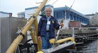 """Martin Klein with a Klein  multibeam side scan sonar. """"We were proud that side scan was able to finally replace the old wire drag technology."""" (courtesy Martin Klein and the MIT Museum)"""