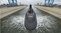 The 7,800-ton Virginia-class submarine John Warner was moved with the help of three tugboats to Newport News Shipbuilding's submarine pier, where final outfitting, testing and crew certification will take place over the next six months. SSN 785 is the first Virginia-class submarine to be named for a person. Photo by Ricky Thompson/HII